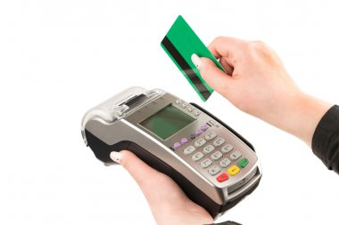 female hand holding a credit card through the terminal
