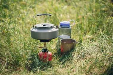 boiling water in kettle on portable camping stove