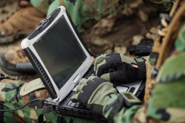ranger using laptop outdoors
