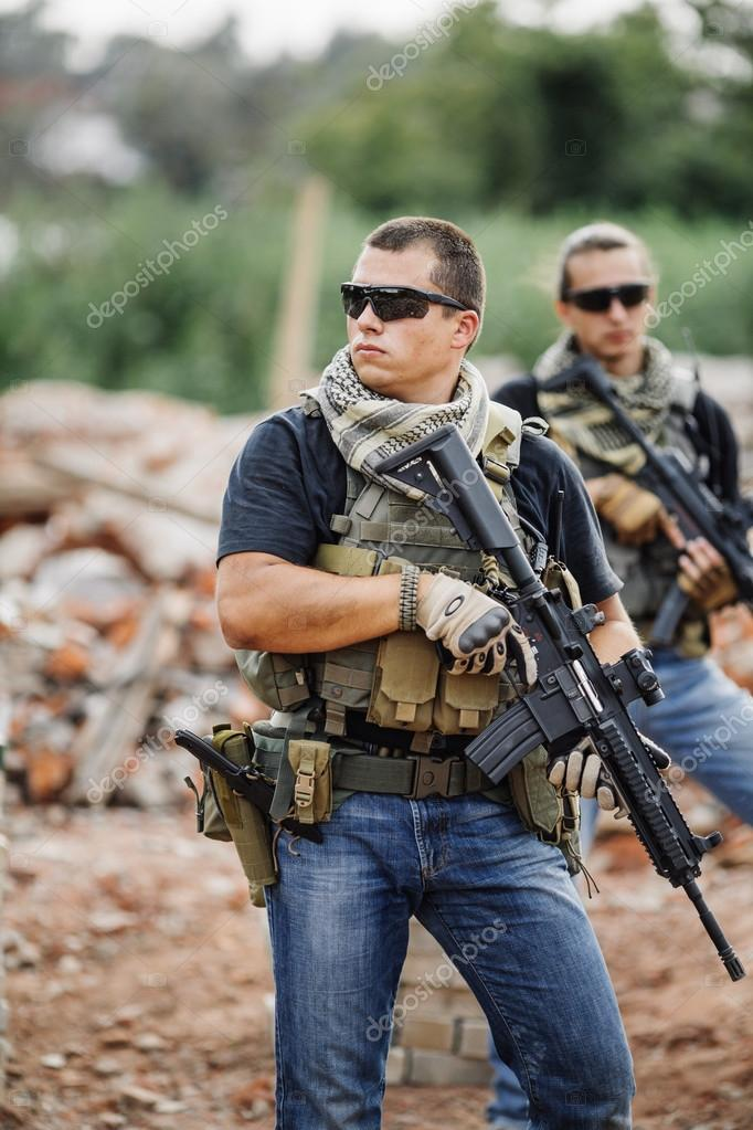 Private Military Contractor on patrol in destroyed city — Stock Photo © kaninstudio #88675492