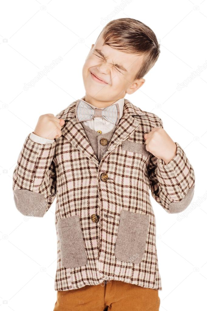 Portrait adorable young happy boy looking at camera isolated on