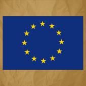 Vlajka Evropského společenství na zmačkaný papír hnědý pozadí.
