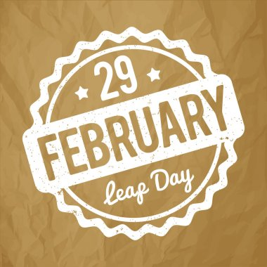 29 February Leap Day rubber stamp white on a crumpled paper brown background.