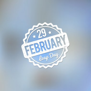 29 February Leap Day rubber stamp white on a light blue bokeh fog background.