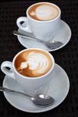 Lahodné cappuccino pěny na černém pozadí