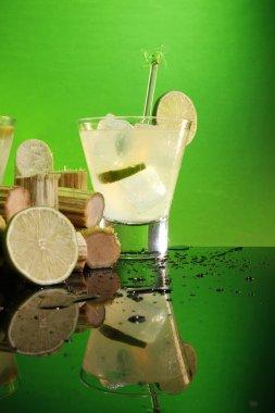 Caipirinha with sugar cane and lime