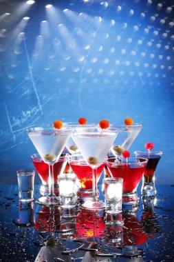 Cocktails glasses on blue