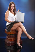 Fotografie Cute girl with laptop and cigar