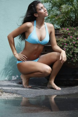 Brunette young girl in blue bikini