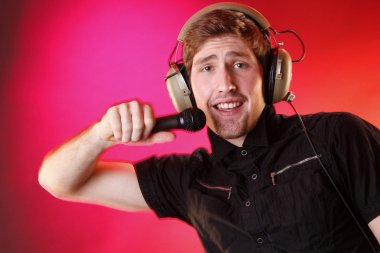 Young man with microphone and headphones