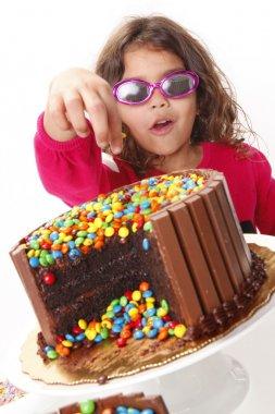 Cute girl with a chocolate cake
