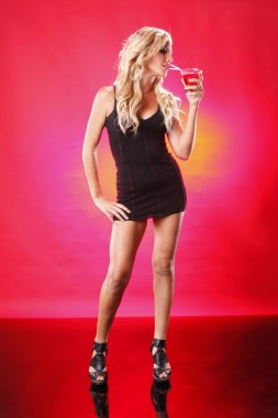Sexy blonde girl with Cosmopolitan cocktail