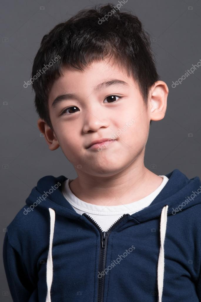 Little asian boy on gray background — Stock Photo