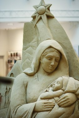 madonna with baby Jesus sculpted in stone with stars.