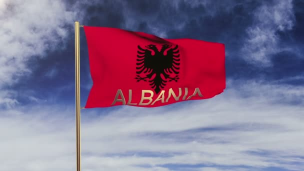 Albania flag with title waving in the wind. Looping sun rises style.  Animation loop