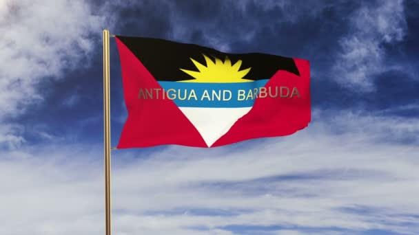 Antigua And Barbuda flag with title waving in the wind. Looping sun rises style.  Animation loop