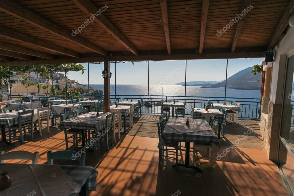 restaurant with view on the sea and mountains fish village bali on crete island in greece photo by zazamaza