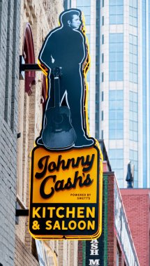 Neon signage in Nashville, Tennessee of Johnny Cash's Kitchen and Saloon