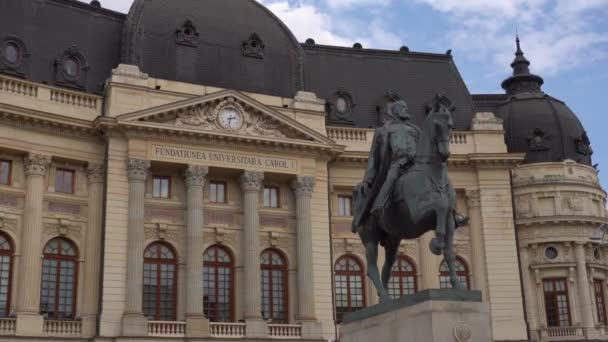 4k video of The Bucharest National Central University library building with statue of King Carol I Of Romania. Travel video with city architecture