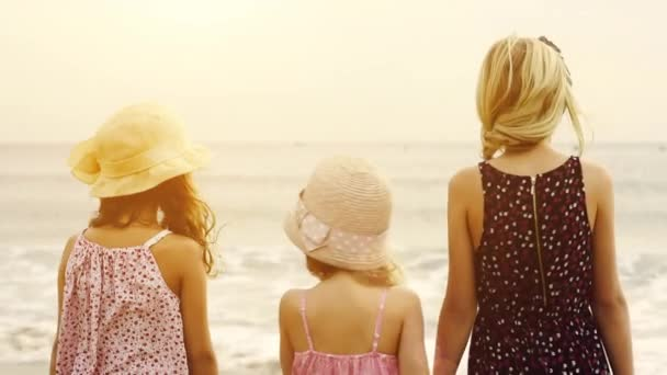 sisters standing on sea shore