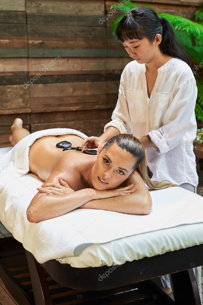 Asian back massage theraphy spa hot stone– stock image