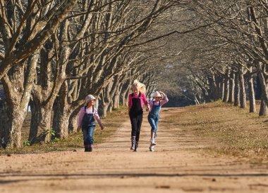 girls  skipping down road