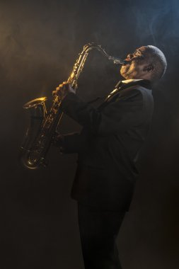 Saxophonist playing on instrument