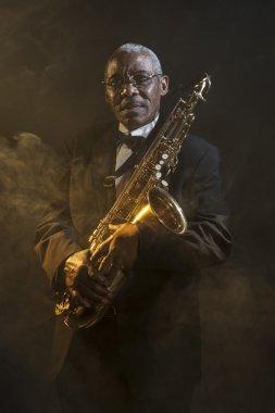 Saxophonist holding instrument