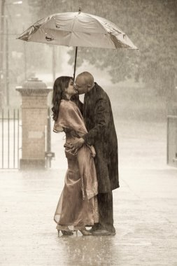 Indian couple under rain