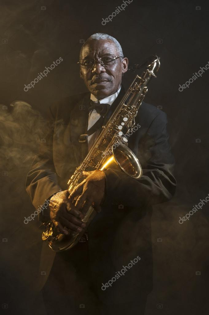 Saxophonist holding instrument