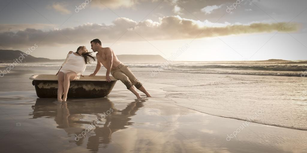 couple on beach with old bath