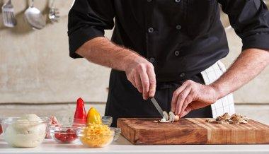 chef cutting mushrooms