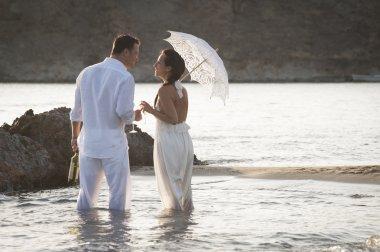Couple standing in ocean water