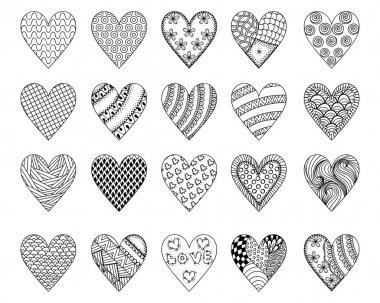 Hand drawn ethnic ornamental patterned hearts with love in doodl