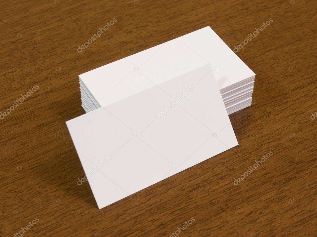 blank business cards on brown wooden table stock photo