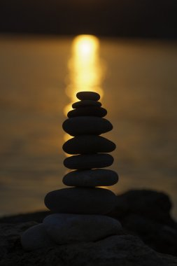 Silhouette of stack of balanced pebbles