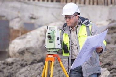Surveyor At Consruction Site