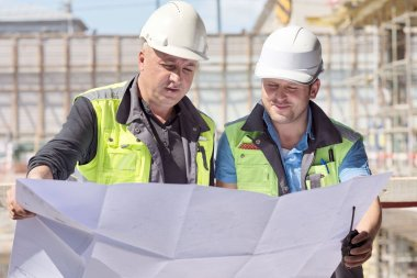 Civil Engineer And Senior Foreman At Construction Site