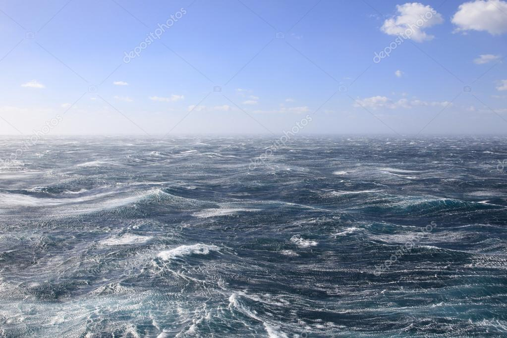 Very rough seas and blue skies