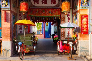 Rickshaw tricycles near the entrance to Hock Teik Cheng Sin Temple, Penang