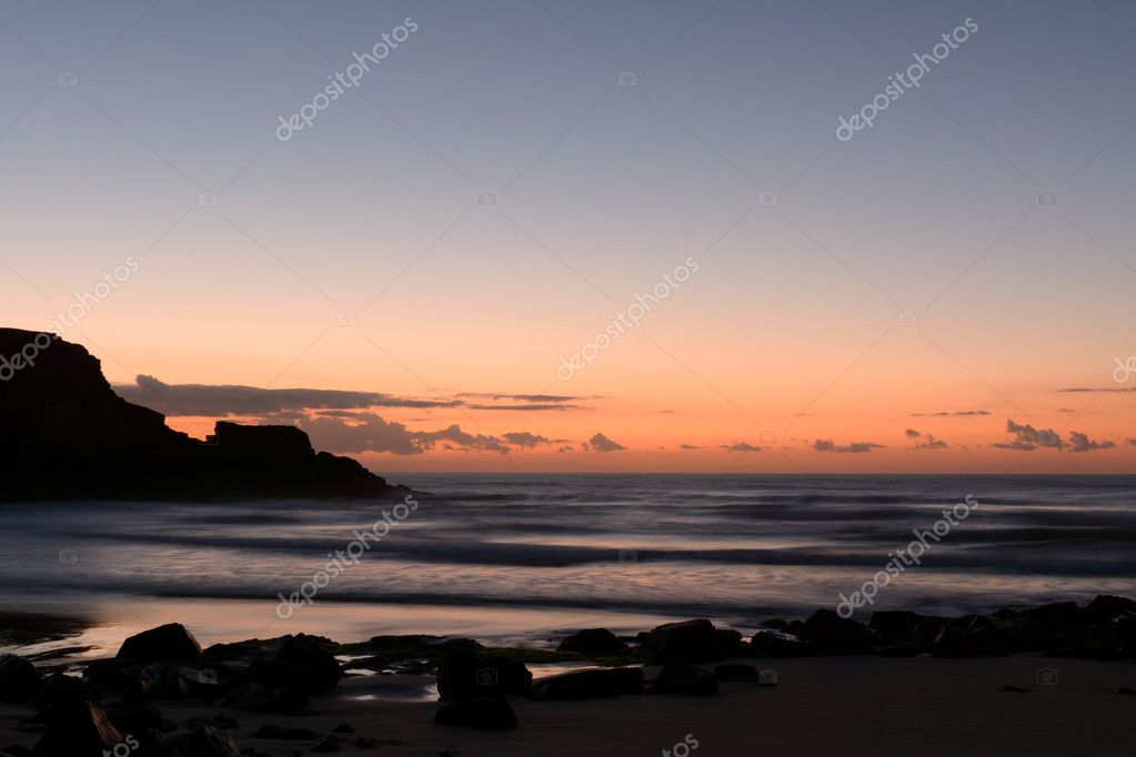 Sunrise at the beach and rocks