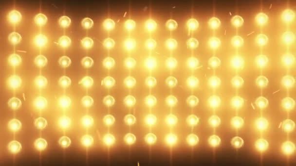 Světlé záplava světla pozadí s částicemi a záře. Zlatý odstín. Bezešvá smyčka