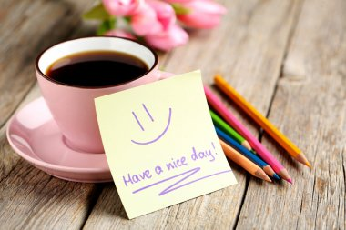 Have a nice day note with coffee and pencils