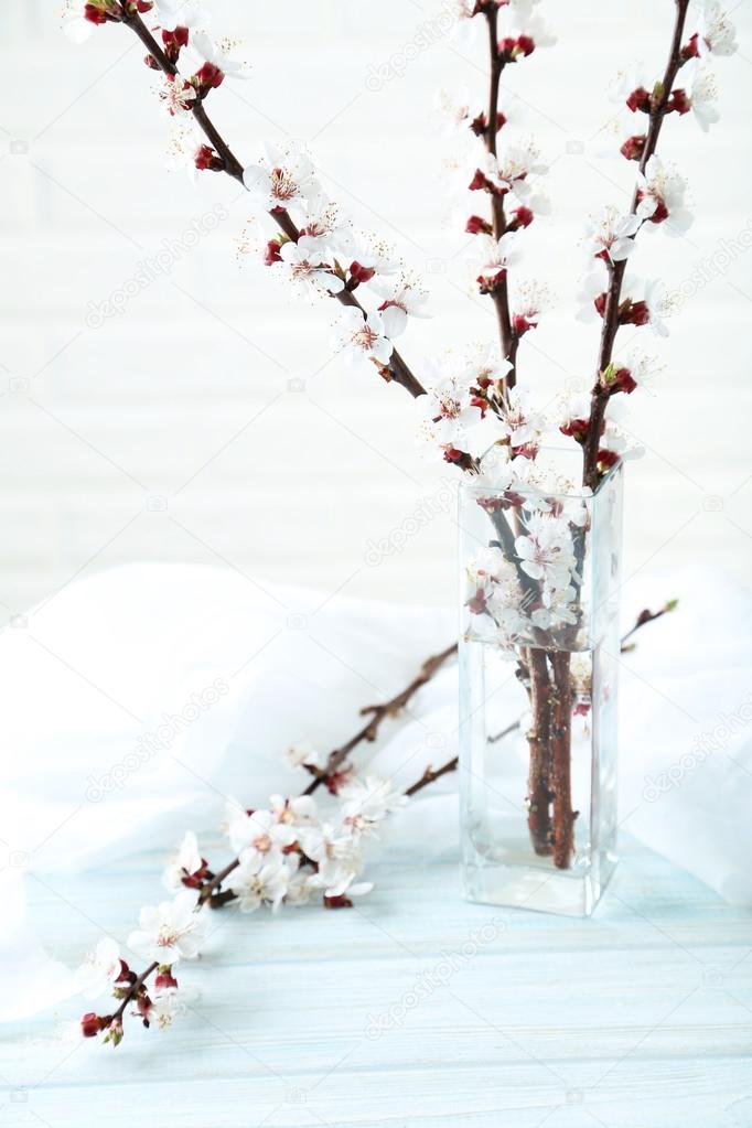 Tree Branches With Flowers In Vase On Blue Wooden Table Stock