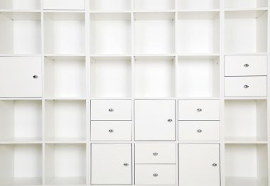 Empty shelves in white rack