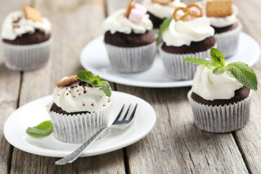 Chocolate cupcakes on wooden table