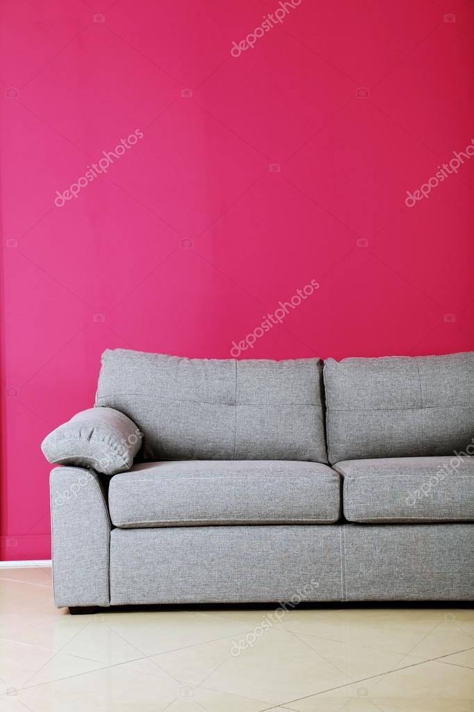 Grey sofa on a pink background — Stock Photo © 5seconds #113381622