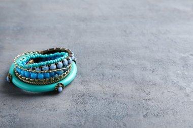 Beautiful bracelets on a grey table