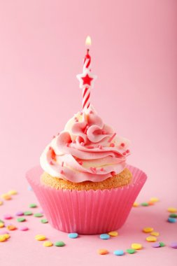 Tasty cupcake with candle