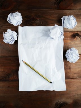 Sheet of blank paper and a pencil